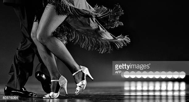 The Argentine couple of Jorge Marino and Sara Parnigoni dances during the first day of the qualifying round of the Stage Tango competition at the 6th...