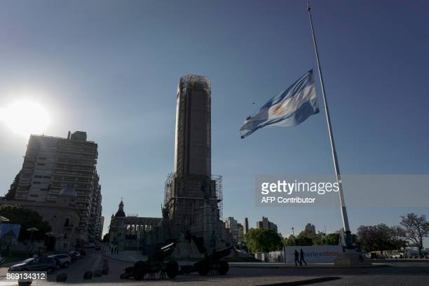 The Argentine national flag flies at halfmast in Rosario some 350 Km northwest of Buenos Aires Argentina on November 1 2017 as a sign of mourning for...