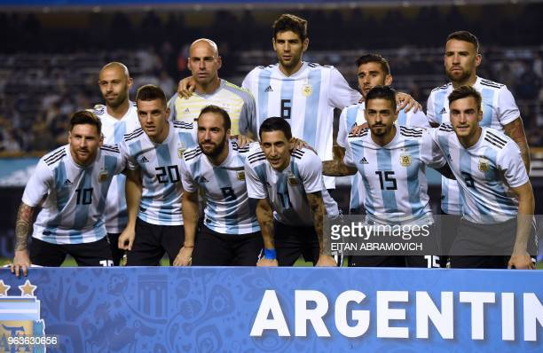 The Argentine national football team poses for pictures before the start of the international friendly football match against Haiti at Boca Juniors'...