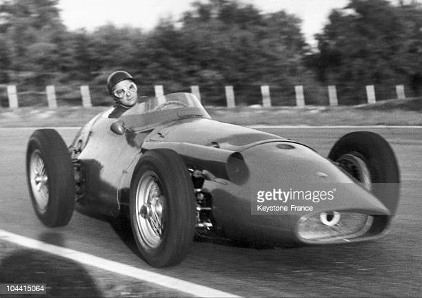 The Argentine racecar driver Juan Manuel FANGIO then current world champion competing for the Grand Prix of Italy in his 12cylinder MASERATI on the...