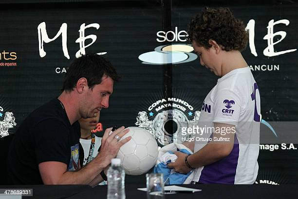 The Argentine star Lionel Messi signed autographs for several small Children's Rehabilitation Center Telethon during his visit in Cancun Mexico's...