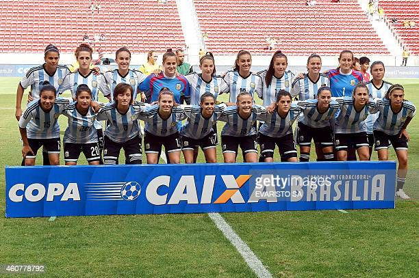The Argentine women's national football team poses before a match of the 2014 Brasilia International Tournament at the Mane Garrincha national...