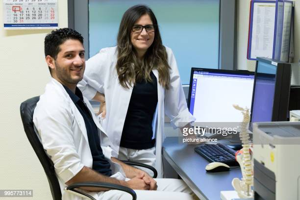 The Argentinian doctors Alvaro Navarro and Diana Grau photographed at a treatment room of the Borromaeus Hospital in Leer Germany 2 October 2017 In...