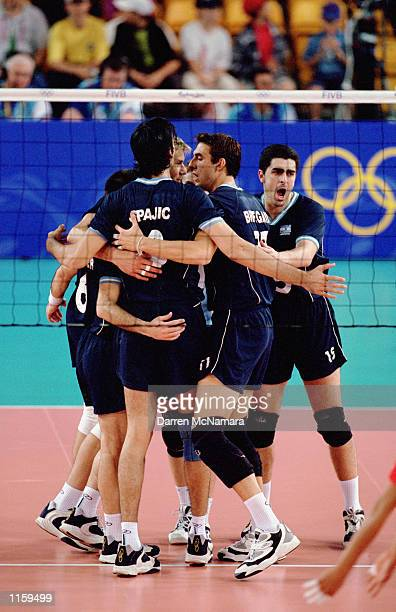 The Argentinian Men's Volleyball Team celebrates during the Olympic Men's Indoor Volleyball competition at the Sydney Entertainment Center in Sydney,...