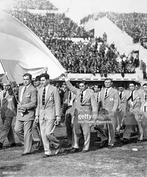 The Argentinian team and officials parade around the ground during the ceremony to officially open the Estadio Centenario in Montevideo prior to the...