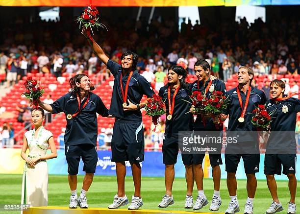 The Argentinian team celebrate gold during during the Men's Final between Nigeria and Argentina at the National Stadium on Day 15 of the Beijing 2008...