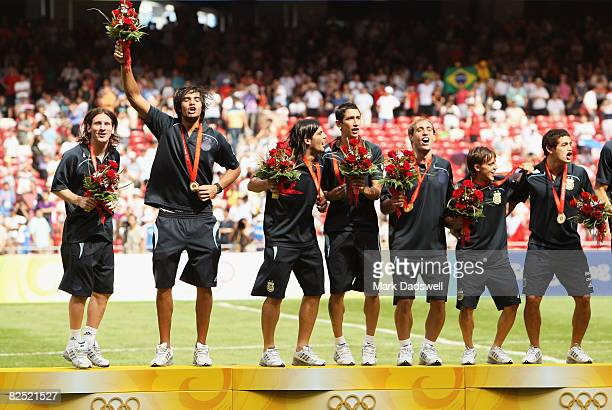 The Argentinian team celebrate gold during the medal ceremony for the Men's Football at the National Stadium on Day 15 of the Beijing 2008 Olympic...
