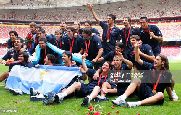 The Argentinian team celebrate gold during the Men's Final between Nigeria and Argentina at the National Stadium on Day 15 of the Beijing 2008...