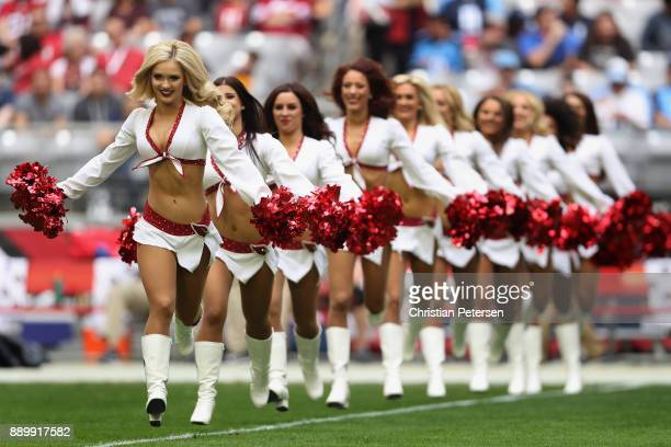 The Arizona Cardinals cheerleaders peform before the NFL game against the Tennessee Titans at the University of Phoenix Stadium on December 10 2017...
