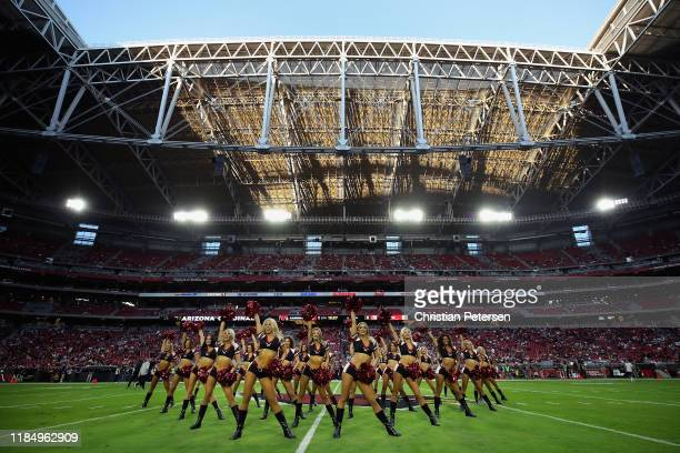 The Arizona Cardinals cheerleaders perform before the NFL game against the San Francisco 49ers at State Farm Stadium on October 31 2019 in Glendale...