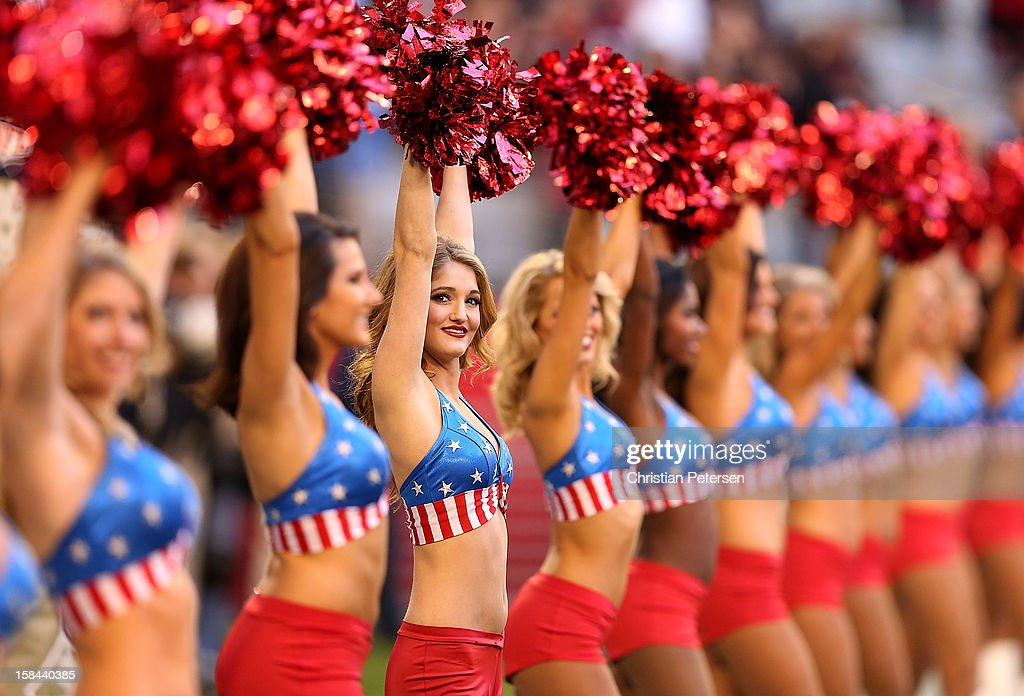 The Arizona Cardinals cheerleaders perform during the NFL game against the Detroit Lions at the University of Phoenix Stadium on December 16, 2012 in Glendale, Arizona. The Cardinals defeated the Lions 38-10.