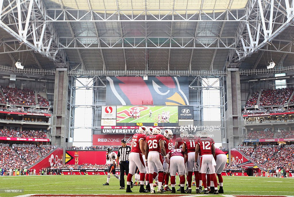 The Arizona Cardinals huddle up during the NFL game against the Chicago Bears at the University of Phoenix Stadium on December 23, 2012 in Glendale, Arizona. The Bears defeated the Cardinals 28-13.