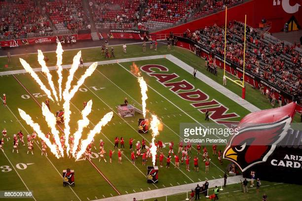 The Arizona Cardinals run out onto the field bfore the NFL game against the Jacksonville Jaguars at the University of Phoenix Stadium on November 26...