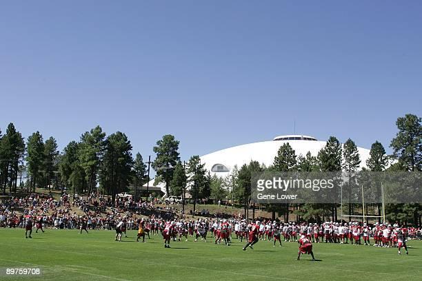 The Arizona Cardinals run through drills during training camp on August 7 2009 in Flagstaff Arizona