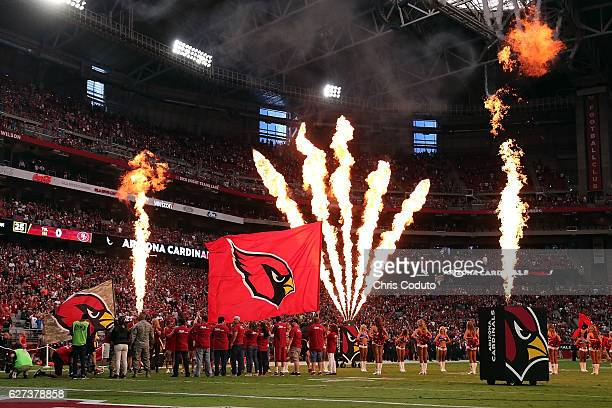 The Arizona Cardinals take the field before the start of the NFL football game against the San Francisco 49ers at University of Phoenix Stadium on...