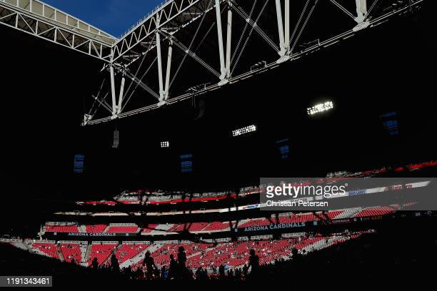 The Arizona Cardinals warm up before the NFL game against the Los Angeles Rams at State Farm Stadium on December 01, 2019 in Glendale, Arizona. The...