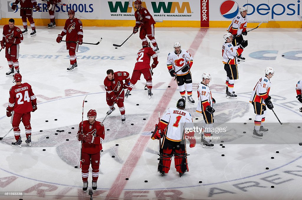 The Arizona Coyotes and the Calgary Flames warm up before the NHL game at Gila River Arena on January 15, 2015 in Glendale, Arizona.