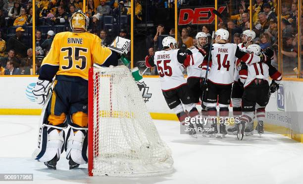 The Arizona Coyotes celebrate a goal against Pekka Rinne of the Nashville Predators during an NHL game at Bridgestone Arena on January 18 2018 in...