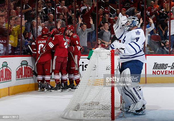 The Arizona Coyotes celebrate after Sam Gagner scored a first period goal past goaltender James Reimer of the Toronto Maple Leafs during the NHL game...