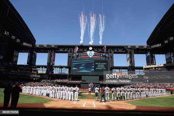 The Arizona Diamondbacks and the San Francisco Giants stand attended for the national anthem before the MLB opening day game at Chase Field on April...