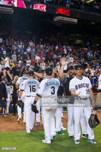 The Arizona Diamondbacks celebrate after defeating the Los Angeles Dodgers at Chase Field on April 21 2017 in Phoenix Arizona
