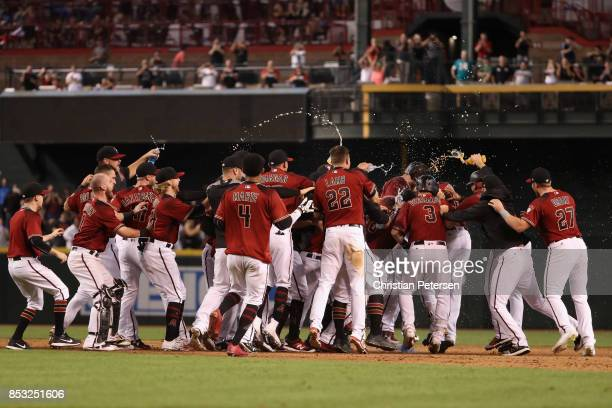 The Arizona Diamondbacks celebrate after JD Martinez had a game winning RBI single against the Miami Marlins during the ninth inning of the MLB game...