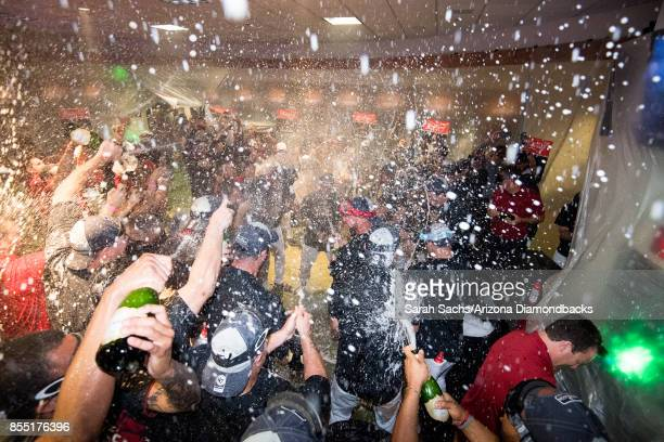 The Arizona Diamondbacks celebrate in the locker room after defeating the Miami Marlins and clinching a postseason berth following the MLB game at...
