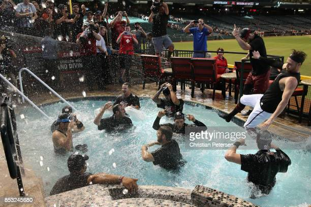 The Arizona Diamondbacks celebrate in the outfield pool after defeating the Miami Marlins and clinching a post season birth following the MLB game at...