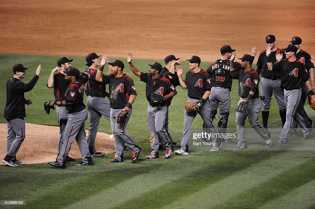 The Arizona Diamondbacks celebrate the win against the Colorado Rockies at Coors Field on June 24, 2016 in Denver, Colorado. The Diamondbacks defeat the Rockies 10-9.