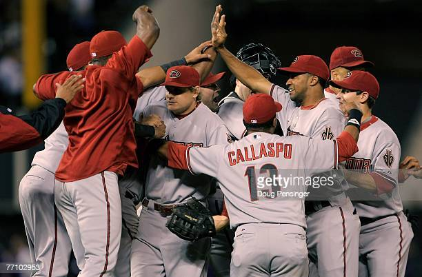The Arizona Diamondbacks celebrate their victory over the Colorado Rockies and clinching a playoff birth at Coors Field on September 28 2007 in...