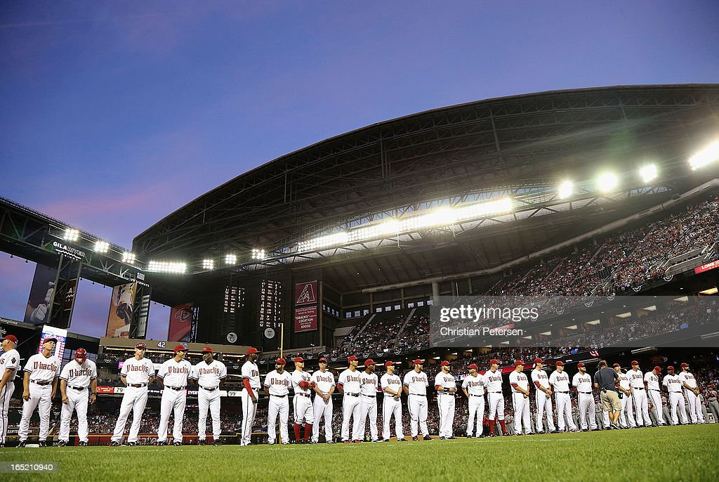 The Arizona Diamondbacks line up for introductions before the MLB Opening Day game against the St. Louis Cardinals at Chase Field on April 1, 2013 in Phoenix, Arizona.