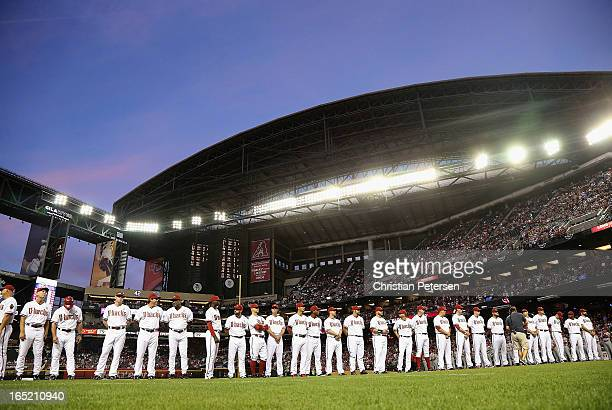 The Arizona Diamondbacks line up for introductions before the MLB Opening Day game against the St Louis Cardinals at Chase Field on April 1 2013 in...