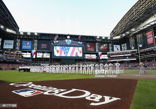 The Arizona Diamondbacks line up for the National Anthem before the Opening Day MLB game against the San Francisco Giants at Chase Field on March 31...