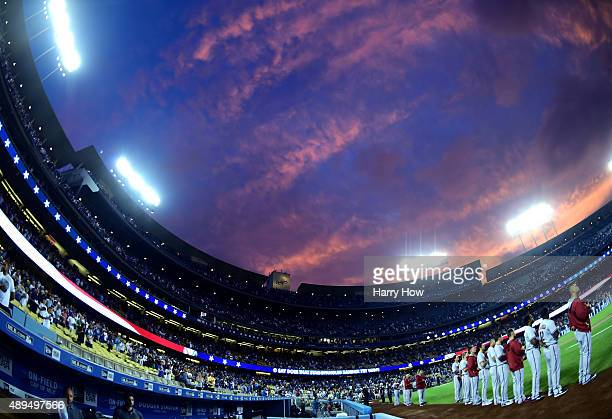 The Arizona Diamondbacks line up for the National Anthem during a sunset before the game against the Los Angeles Dodgers at Dodger Stadium on...