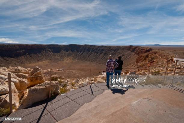 tourists viewing the arizona meteor crater - jeff goulden stock pictures, royalty-free photos & images