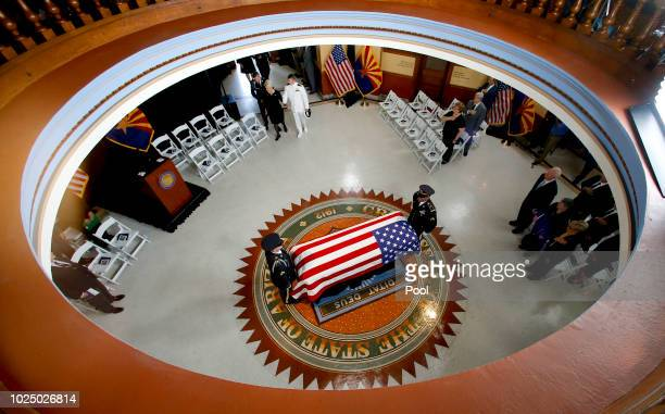 The Arizona National Guard carries the casket into the museum rotunda during a memorial service for Sen. John McCain at the Capitol on August 29,...