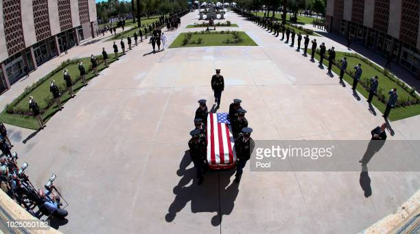 The Arizona National Guard carries the casket of Sen John McCain to his memorial service at the Arizona State Capitol on August 29 2018 in Phoenix...