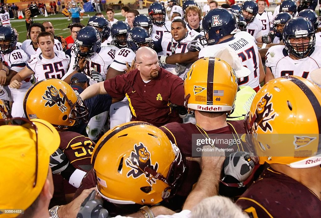 The Arizona State Sun Devils and the Arizona Wildcats come together in a scrum following the college football game at Sun Devil Stadium on November 28, 2009 in Tempe, Arizona. The Wildcats defeated the Sun Devils 20-17.