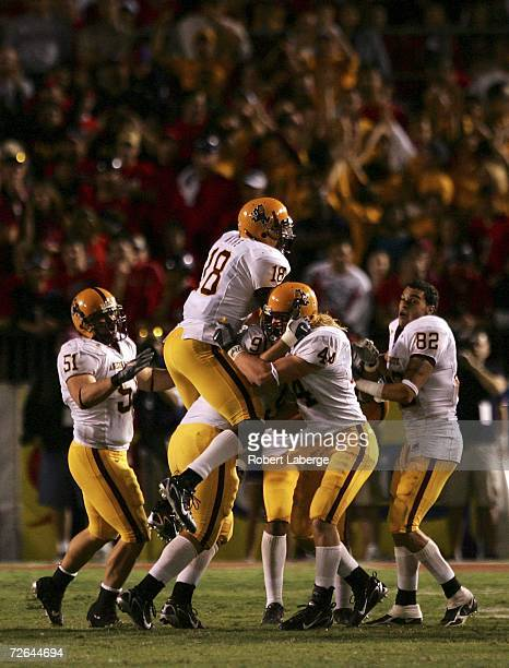 The Arizona State Sun Devils celebrate after a turnover against the Arizona Wildcats at Arizona Stadium on November 25 2006 in Tucson Arizona