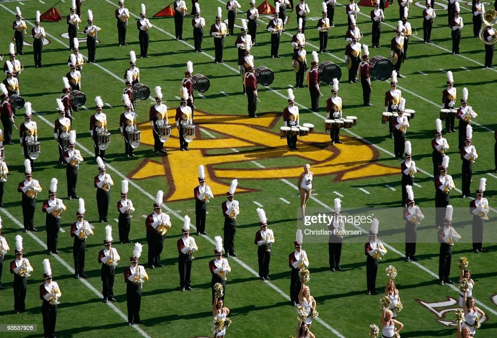 The Arizona State Sun Devils marching band and cheerleaders perform before the college football game against the Arizona Wildcats at Sun Devil Stadium on November 28, 2009 in Tempe, Arizona. The Wildcats defeated the Sun Devils 20-17.