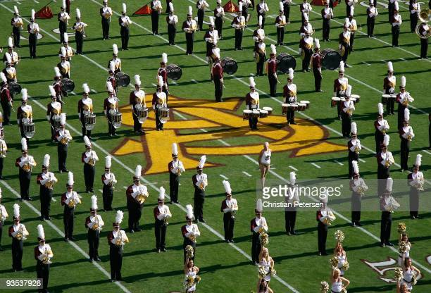 The Arizona State Sun Devils marching band and cheerleaders perform before the college football game against the Arizona Wildcats at Sun Devil...