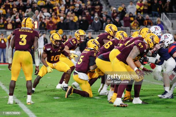 The Arizona State Sun Devils offense runs victory formation during the college football game between the Arizona Wildcats and the Arizona State Sun...