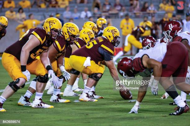 The Arizona State Sun Devil's offensive line sets up during the college football game between the New Mexico State Aggies and the Arizona State Sun...