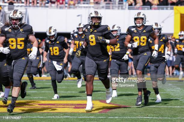 The Arizona State Sun Devils run onto the field before the college football game between the USC Trojans and the Arizona State Sun Devils on November...