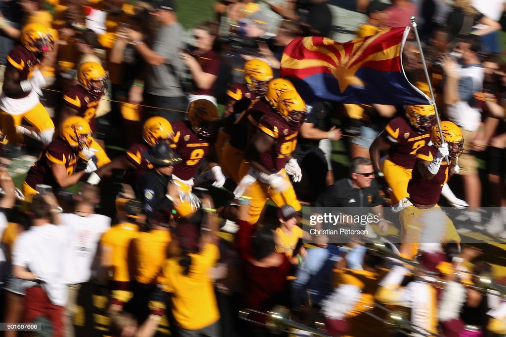 The Arizona State Sun Devils run out onto the field before the college football game against the Arizona Wildcats at Sun Devil Stadium on November 25, 2017 in Tempe, Arizona.