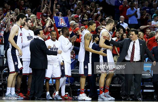 The Arizona Wildcats bench celebrates their 73 to 58 win over the Ohio State Buckeyes during the third round of the 2015 NCAA Men's Basketball...