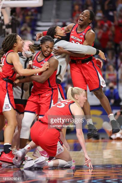 The Arizona Wildcats celebrate after defeating the UConn Huskies during the fourth quarter in the Final Four semifinal game of the 2021 NCAA Women's...