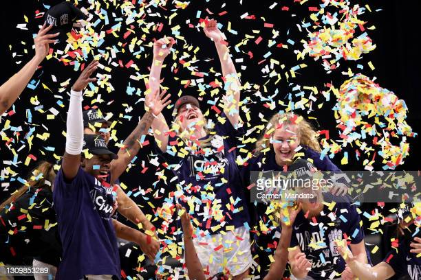 The Arizona Wildcats celebrate their win over the Indiana Hoosiers in the Elite Eight round of the NCAA Women's Basketball Tournament at the...