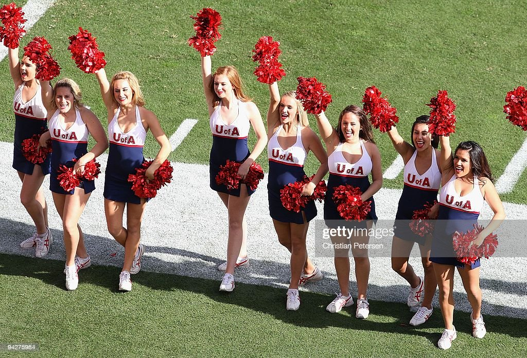 The Arizona Wildcats cheerleaders perform before the college football game against the Arizona State Sun Devils at Sun Devil Stadium on November 28, 2009 in Tempe, Arizona. The Wildcats defeated the Sun Devils 20-17.