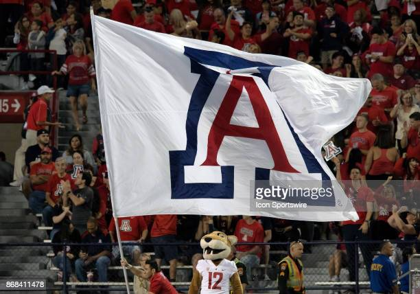 The Arizona Wildcats flag is shown after a scoring drive during the college football game between the Washington State Cougars and the Arizona...